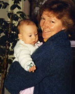 Anne and Becca at a few months old – Anne's cardigan was knitted at Bourn Hall!