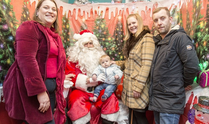 Santa with Angela Leach, fertility nurse, and Victoria, Mark and Alex
