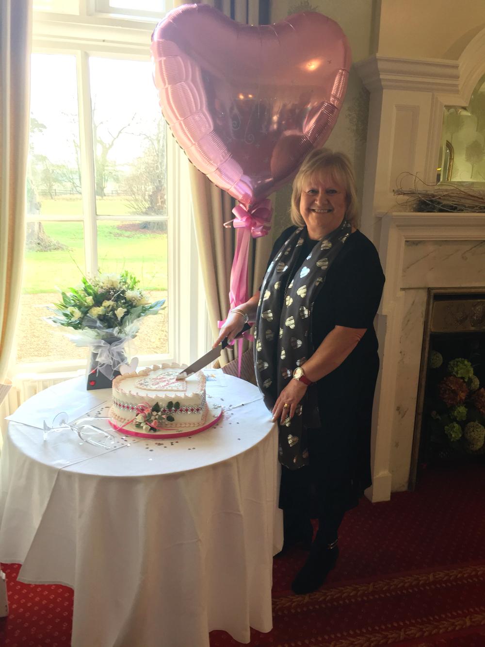 Anne Baldwin cuts her cake