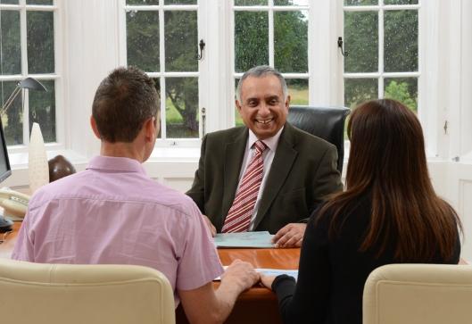 Thomas Mathews talks to a couple at Bourn Hall