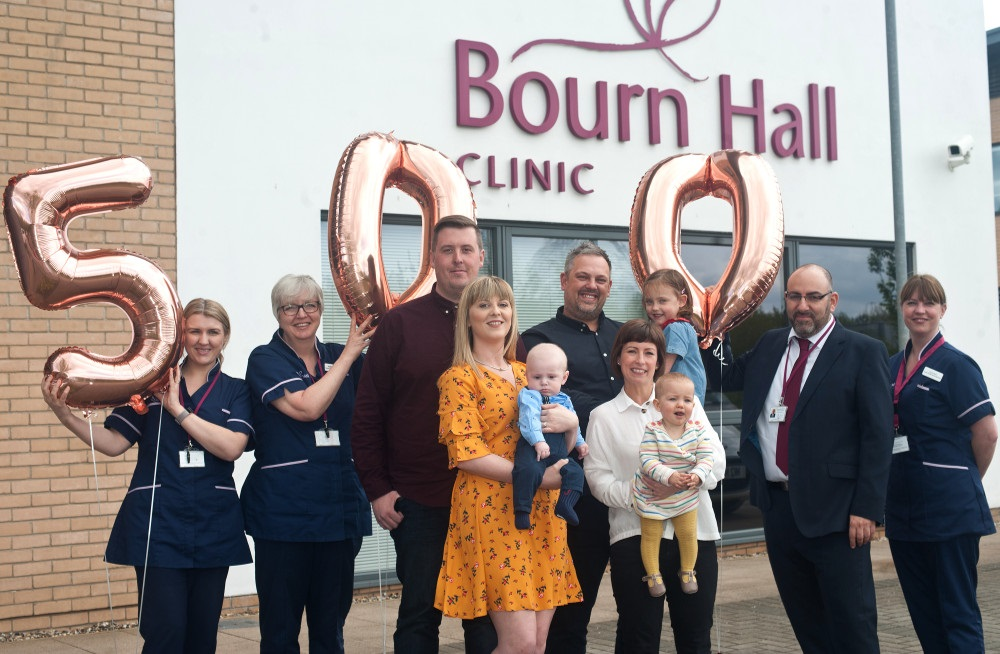 Shepherdson family (left) and Chase family (right) celebrate with staff from Bourn Hall Clinic