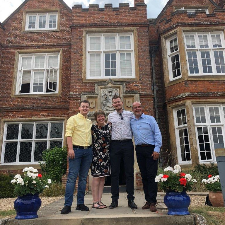 Siobhan and Keith with Tom and Sam outside Bourn Hall